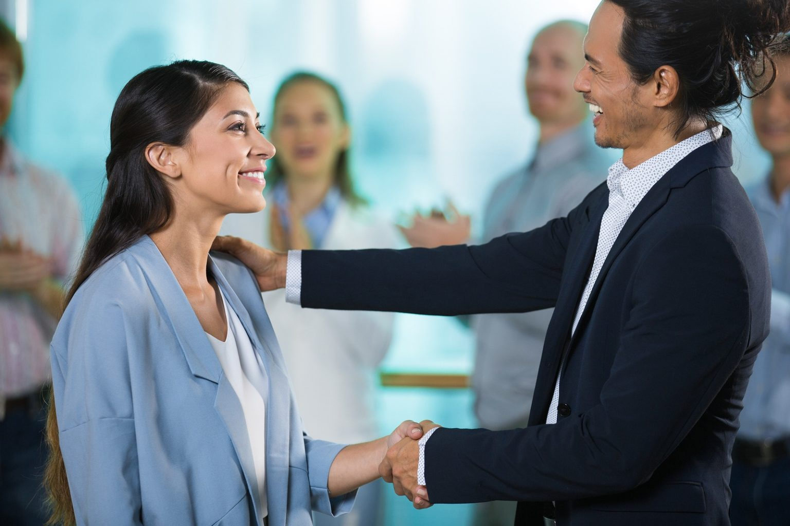 a business man greeting a woman