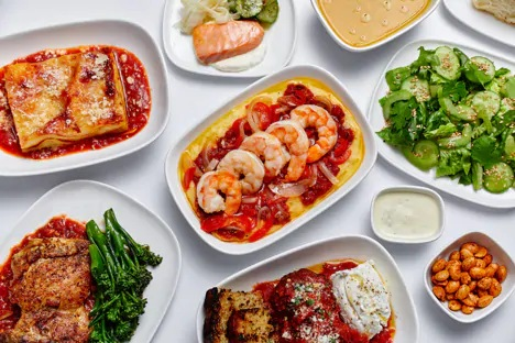 an amazing feast with shrimps, lasagnas and more