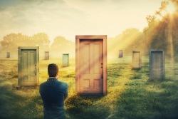 Man looking at a door