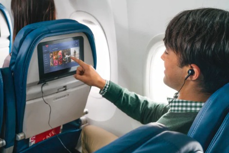 a man listening his favourite song on plane